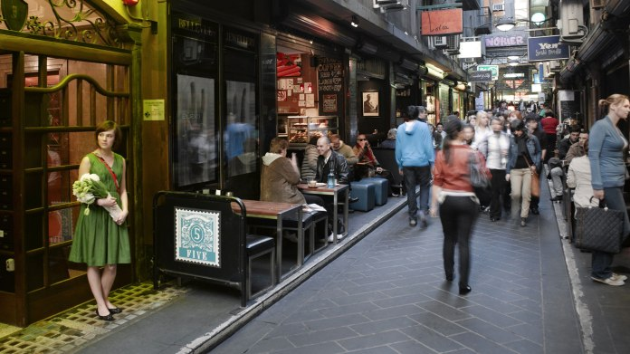 Cafes and pedestrians in a Melbourne laneway