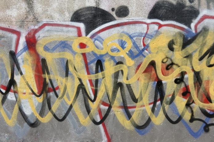 Layers of graffiti on a wall
